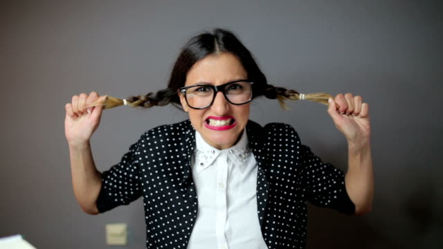 Funny angry woman pulling hair