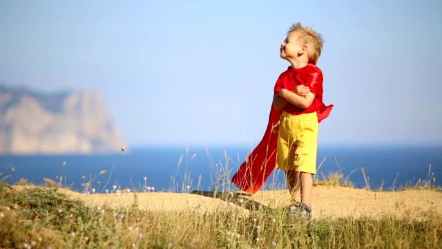 funny boy in superhero costume
