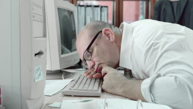 DS Funny business man sleeping on his computer keyboard