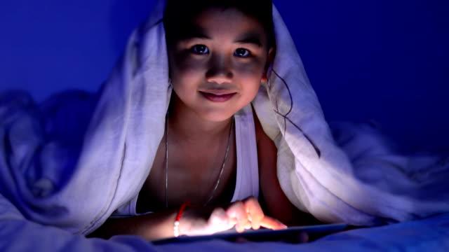 Funny Little Boy Using Digital Tablet