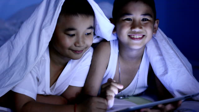 Funny Little Boy Using Digital Tablet