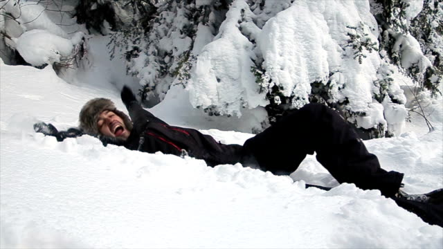 A funny  man throws himself in the snow