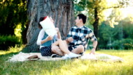 Funny pillow fight on a picnic slowmotion