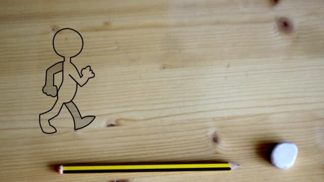 funny puppet comes to life and walk on the desk