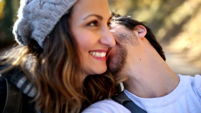 Funny young hipster couple making faces