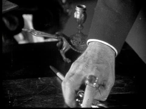 1925 MS B/W Furious man finding dagger