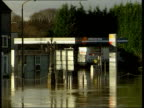 Effects NN U ENGLAND Worcestershire Worcester EXT Swollen River Severn with cathedral in b/g Petrol station standing in flood water Man along flooded...