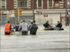 Further heavy rain and flood warnings Hull EXT Rescue workers along flooded streets in boats and dinghies