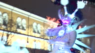Futuristic dancers with children in New Years celebrations outside the Kremlin