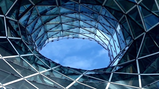 Futuristic glass facade  - time lapse