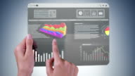 Futuristic tablet with financial data.