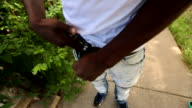 Gang members in South side Chicago placing guns inside their pockets