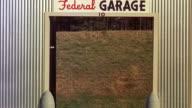 CU  Gangster figure passes doorway of federal garage at hogan's alley / Washington D.C. , United States