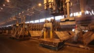 A gantry crane disgards used anodes inside the electrolysis shop at the Irkutsk aluminium smelter operated by United Co Rusal in Shelekhov Russia on...