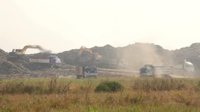 Garbage Trucks work on the landfill