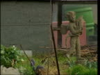 Gardeners in allotment poisoned by weedkiller Music overlaid over end sequence General view allotments Close up vegetable patch with gardener digging...
