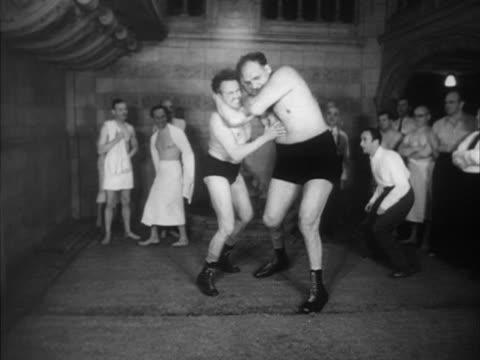 'Gargantua' an eight foot tall wrestler demonstrates his wrestling skills on an opponent