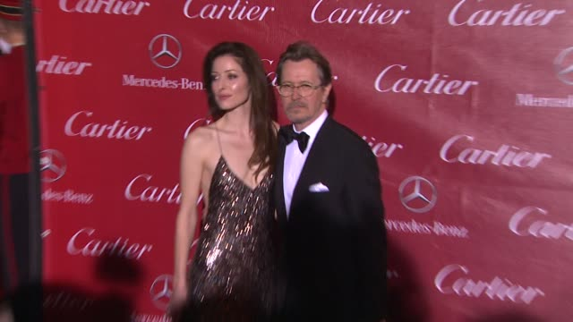 Gary Oldman and Alexandra Edenborough at the 25th Annual Palm Springs International Film Festival Awards Gala Presented By Cartier in Palm Springs CA...