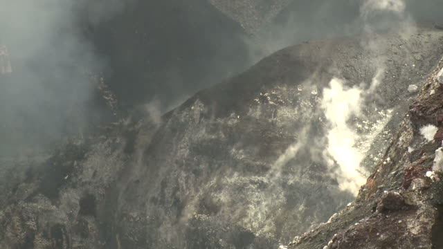 Gases rise from the side of large crater at Marum volcano, Ambrym Island, Vanuatu