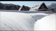 Gasshozukuri Houses surrounded by snow drifts, Shirakawago, Gifu