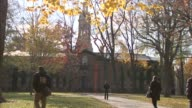 gate outside Princeton campus / students walking on campus / fall weather / autumn colors / Nassau Hall / oldest building at Princeton University...