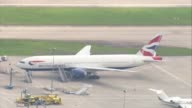 West Sussex Gatwick Airport Gatwick Airport with British Airways aircraft parked at gates and stationary on taxiways / Monarch plane along runway /...