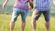 Gay couple dancing in nature