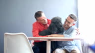 Gay couple sitting with their pet poodle