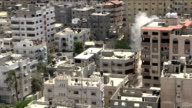 fragile truce continues as Barack Obama calls for immediate ceasefire ISRAEL Gaza EXT High angle shot of city centre buildings as Israeli rocket...