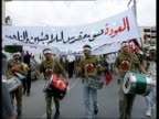 Gaza EXT GV Palestinians towards with banners and placards as part of demonstration to commemorate Naqba day the founding of the Jewish state in...