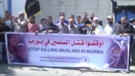 Gazans take part in a rally in support of Muslims in Myanmar and condemn ongoing violence against the Muslim minority by Myanmar's army and...