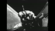 Gemini pilot Richard Gordon's space walk / Gordon attaches tether to Gemini XI to attach to Agena target vehicle / view 400 miles above the earth...