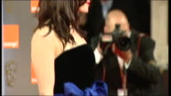 Gemma Arterton poses for press on the red carpet at the British Academy Film Awards 2011