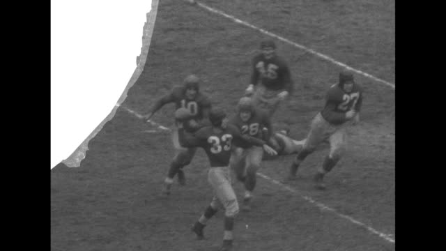 [Gen Dwight Eisenhower is allegedly at this game but is not shown] VS slomo football game between the Washington Redskins and the New York Giants at...