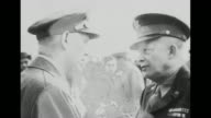 VS Gen George Marshall Army Chief of Staff and Gen Dwight Eisenhower shake hands on tarmac in France / Marshall introduces James F Byrnes director of...