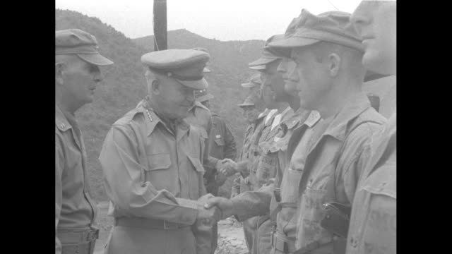 Gen James A Van Fleet arrives at the front greets officers and generals / US Army Chief of Staff Gen J Lawton Collins and Van Fleet get into jeep /...