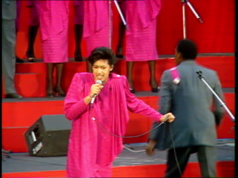 Labour ENGLAND N London Islington TGV Audience standing in hall MS Female gospel singer on stage on stage singing man in BV dances SOF Labour...