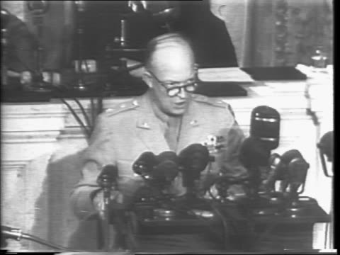 General Dwight D Eisenhower at podium addresses Congress about end of war and pledge to victory / Congress applauds