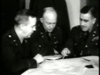 General Dwight D Eisenhower 'Ike' at table w/ officers looking at map MS Hand amp pencil tracing over map MS Joint Chief of Staff Generals amp...