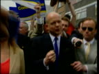 Campaigning ITN ENGLAND Northampton William Hague MP along off campaign bus with wife Ffion Hague shaking hands with supporters in crowd some waving...