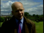 Campaigns ITN ENGLAND Yorkshire William Hague sat at kitchen table with others Hague EXT Hague seen thru window of house ENGLAND London Conservative...