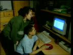 Crime/Paedophiles LIB Mother and children using computer