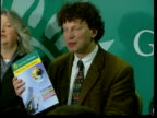 Green Party manifesto launch ITN ENGLAND London Westminster Green Party press conference to launch manifesto Man holding up copy of manifesto...