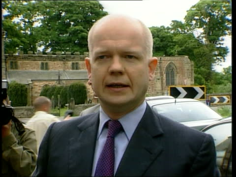 General Election 2001 ITN William Hague out of car to shake hands with man William Hague speaking to press SOT Asylum is entirely separate issue from...