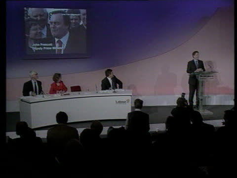 John Prescott profile LIB ENGLAND London Millbank INT Blair at podium for press conference TGV Blair at podium with Prescott on giant screen in b/g...