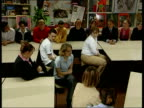 Labour Party Tony Blair EN BILL NEELY ENGLAND Yorkshire Halifax The Ridings School INT Prime Minister Tony Blair into classroom in secondary school...