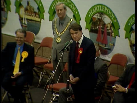 Labour victory/ William Hague resigns ENGLAND Hartlepool Peter Mandelson MP sitting on stage in hall GV Count officials in hall Peter Mandelson MP...