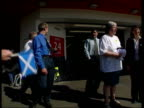Scotland ITN SCOTLAND Edinburgh i/c SCOTLAND Inverness Seq SNP party workers canvassing outside supermarket TMS Children holding Scottish flags INT...