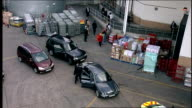 Brown visits Asda in Telford EXT Cars of Brown entourage parked in loading bay / Vote Labour placards handed to people / cars parked in loading bay /...