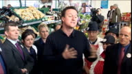 Cameron visits Tescos WALES Delyn Tesco supermarket Holywell PHOTOGRAPHY*** David Cameron along in supermarket Terry Leahy introduces Cameron SOT...